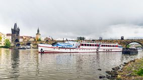 Tourist ship on the background of the Charles Bridge in Prague stock images