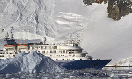 Tourist ship on the background of mountains and glaciers of the Stock Photo