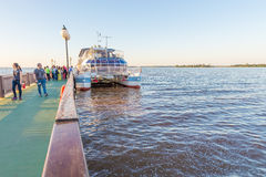 Tourist ship boarding people and gettting ready for a tour. Foz do Iguacu, Brazil - july 10, 2016: Tourist ship boarding people and getting ready for a tour over Stock Photography