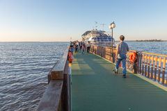 Tourist ship boarding people and gettting ready for a tour. Foz do Iguacu, Brazil - july 10, 2016: Tourist ship boarding people and getting ready for a tour over Royalty Free Stock Photo