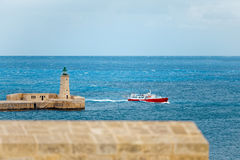 Tourist ship enters the port of Valletta, Malta.  Royalty Free Stock Image