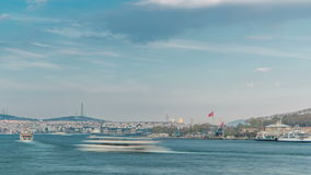 Tourist ship and ferris traffic on Bosphorus timelapse view from Galata Bridge in Istanbul, Turkey. City skyline with Camlica hill on background before sunset stock video
