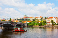 Tourist the ship floats under Charles bridge Royalty Free Stock Images