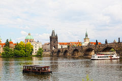 Tourist the ship floats under Charles bridge Royalty Free Stock Photo
