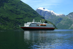 Tourist ship in Geiranger fjord Stock Photo
