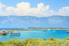 Tourist ship with mountain in background Royalty Free Stock Photography