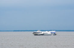 Tourist ship on the open water Royalty Free Stock Images