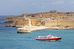 Tourist ship sails in front of St. Elmo, Malta.  Royalty Free Stock Photo