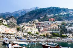 Tourist ships  in visitfamous and picturesque port in Positano Stock Image