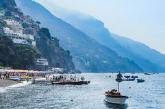 Tourist ships  in visitfamous and picturesque port in Positano Stock Photo