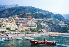 Tourist ships  in visitfamous and picturesque port in Positano Stock Photography