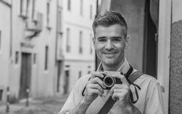 Tourist shooting in the street Royalty Free Stock Photography