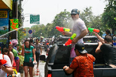 Tourist shoots from his water gun Royalty Free Stock Images
