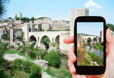Tourist shoots photo of bridge in Besalu town Royalty Free Stock Photography