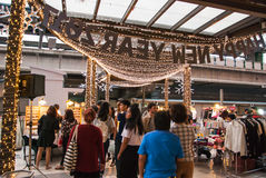 Tourist shopping in weekend market Royalty Free Stock Photo