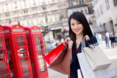 Tourist shopping. Young chinese tourist shopping in London Royalty Free Stock Photo