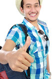 Tourist showing thumb up Stock Photo