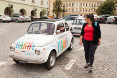 Tourist in Sibiu near small car Royalty Free Stock Images