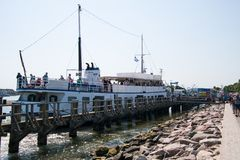 Tourist sightseeing boat at dock loading passengers stock photos