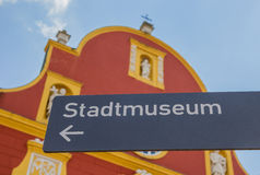 Tourist sign in front of the Gymnasial church in Meppen Stock Photography