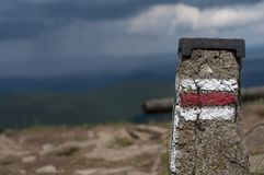 Tourist sign or mark in mountains in Poland - Bieszczady. Beautiful, peaceful, green mountains in Poland - Bieszczady during summer Royalty Free Stock Photo
