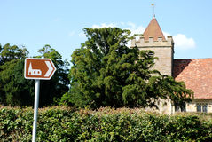 Tourist sign points towards historic church Royalty Free Stock Image