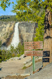 Tourist sign and waterfall in Yosemite Stock Images