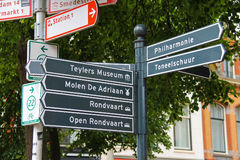 Tourist signpost at the crossroads in the centre of Haarlem. Haarlem, the Netherlands - June 20, 2015: Tourist signpost at the crossroads in the city centre royalty free stock image