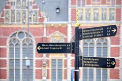 Tourist signs out of the station in Amsterdam Royalty Free Stock Photos