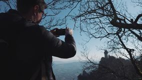 Tourist silhouette makes photo of ancient building stock video footage