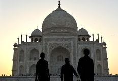 Tourist silhouette and Taj Mahal. Three person visiting the mausoleum of Taj Mahal before sunset Stock Photography