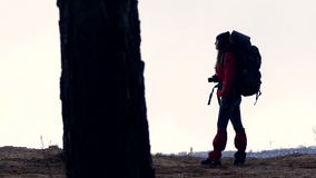 The tourist silhouette is walking away looking around. stock footage