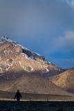Tourist sillhouette walking along Chimborazo Royalty Free Stock Photo