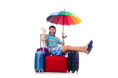 Tourist sits on bags isolated on white Stock Photography