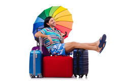 Tourist sits on bags isolated on the white Royalty Free Stock Image