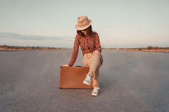 Tourist sits on a suitcase Royalty Free Stock Photo
