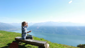 Tourist sitting on bench looking at map on digital tablet stock footage