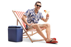 Tourist sitting in deck chair and looking at the camera Stock Photography