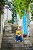 Tourist sitting on stairs in Positano, Italy Royalty Free Stock Image