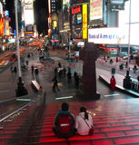 Tourist sitting on times square steps Royalty Free Stock Photos