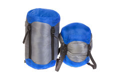Tourist sleeping bags  packed with varying degrees of compressio Royalty Free Stock Photo