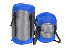 Tourist sleeping bags packed with varying degrees of compression Stock Images