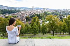 Tourist with smart phone camera in Bern Royalty Free Stock Photos