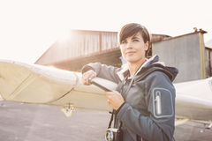 Tourist with smartphone at the aerodrome royalty free stock images