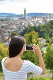 Tourist with smartphone camera in Bern Switzerland Royalty Free Stock Image