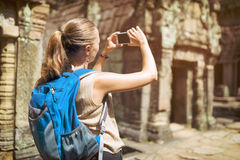 Tourist and smartphone in Preah Khan temple in Angkor, Cambodia Stock Photography