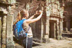 Tourist with smartphone in Preah Khan temple in Angkor, Cambodia Stock Images