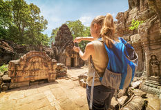 Tourist with smartphone in the ruins of Angkor, Cambodia Stock Photography
