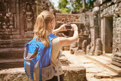 Tourist with smartphone in the temple. Angkor, Cambodia Royalty Free Stock Photo