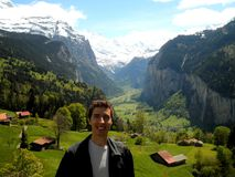Tourist Smiling Lauterbrunnen Valley. Happy tourist smiling in the beautiful Lauterbrunnen Valley stock photo